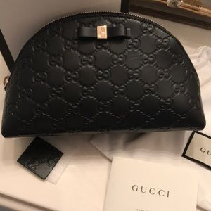 Authentic Gucci cosmetic bag. New